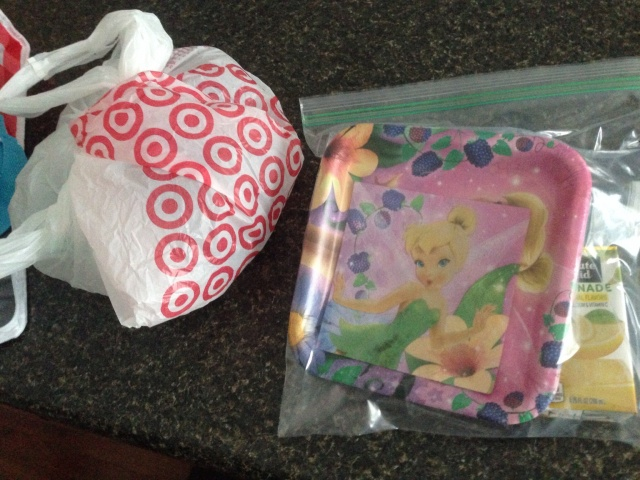 The cupcakes were in a Ziploc bag and then in a Target bag.  There's the Tinker Bell plate & napkin!