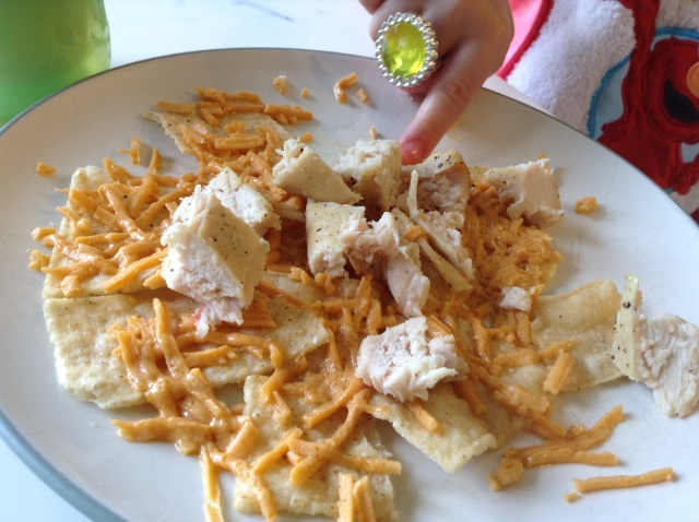 """Plain"" Chicken and Daiya Cheddar Shreds Nachos.  And a jeweled three year old's hand."